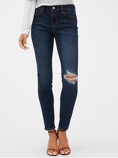 Mid Rise Destructed Legging Jeans