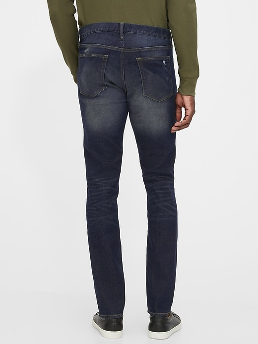 Mid Rise Distressed Skinny Jeans with GapFlex